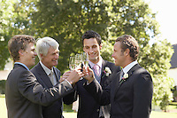 Four men toasting at wedding