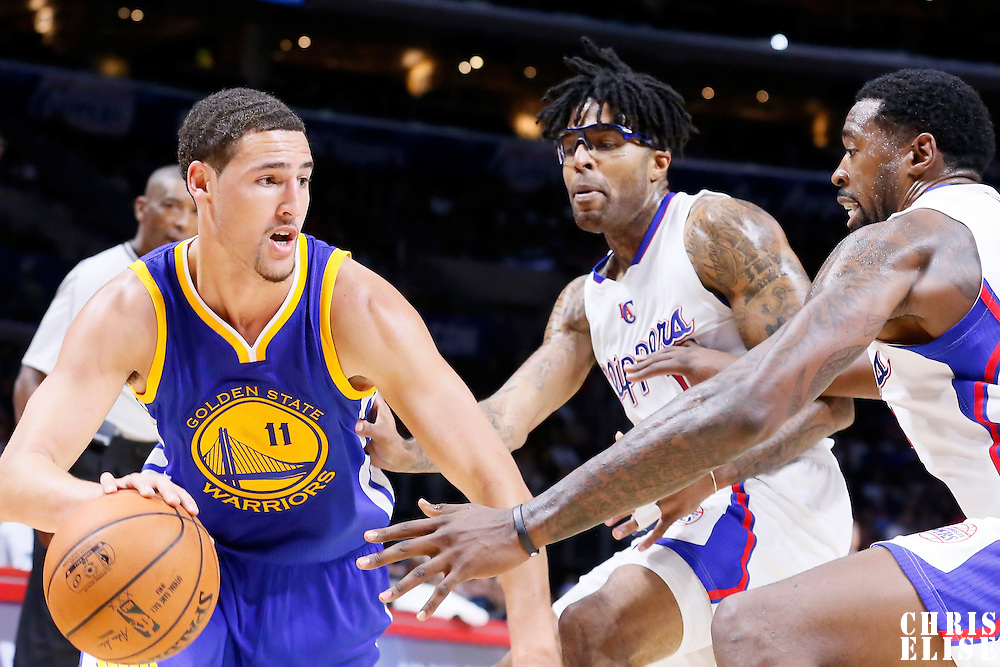 07 October 2014: Golden State Warriors guard Klay Thompson (11) drives past Los Angeles Clippers guard Chris Douglas-Roberts (14) and Los Angeles Clippers center DeAndre Jordan (6) during the Golden State Warriors 112-94 victory over the Los Angeles Clipper, in preseason opener, at the Staples Center, Los Angeles, California, USA.