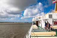 DEU, Germany, Schleswig-Holstein, ferry boat of the shipping company Wyker Dampfschiffs-Reederei from Dagebuell to Amrum island, in the background Foehr island.<br /> <br /> DEU, Deutschland, Schleswig-Holstein, Faehre der Wyker Dampfschiffs-Reederei von Dagebuell nach Amrum, im Hintergrund die Insel Foehr.