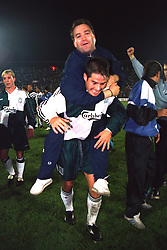 VLADIKAVKAZ, RUSSIA - Tuesday, September 12, 1995: Liverpool's match-winning goal-scorer Jamie Redknapp celebrates with a supporter after his goal sealed a 2-1 victory over FC Alania Spartak Vladikavkaz during the UEFA Cup 1st Round 1st Leg match at Republican Spartak Stadium. (Photo by David Rawcliffe/Propaganda)