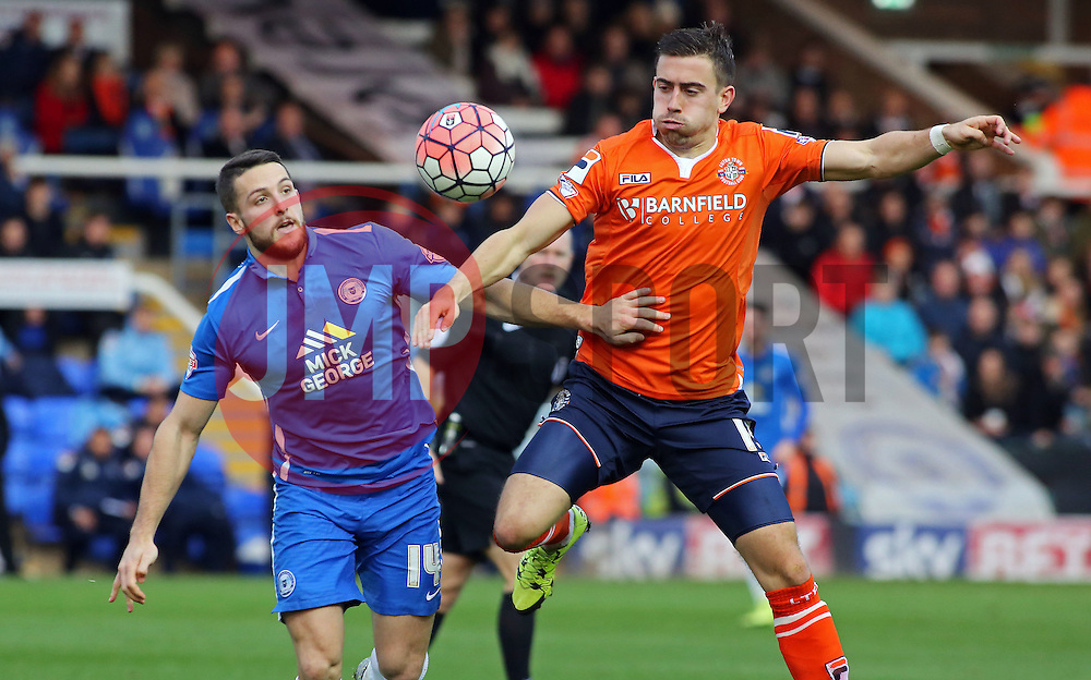 Conor Washington of Peterborough United in action with Oliver Lee of Luton Town - Mandatory byline: Joe Dent/JMP - 06/12/2015 - Football - ABAX Stadium - Peterborough, England - Peterborough United v Luton Town - FA Cup