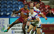 Jermaine McGillvary of Huddersfield Giants tackles Tom Johnstone of Wakefield Trinity during the Betfred Super League Super 8's match at the John Smiths Stadium, Huddersfield<br /> Picture by Stephen Gaunt/Focus Images Ltd +447904 833202<br /> 31/08/2018