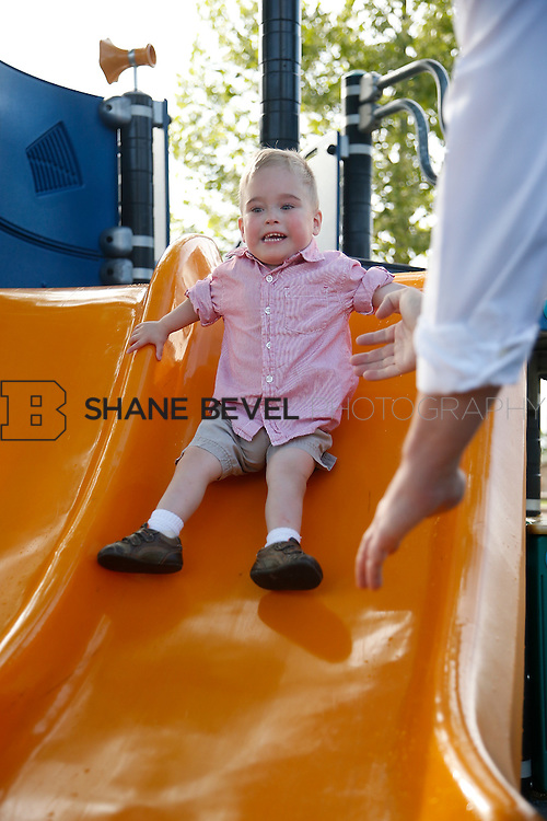 5/28/15 6:06:27 PM -- Miracle Miles and his family pose for portraits and play at the QuikTrip park for the 2015 Saint Francis Health System advertising campaign. <br /> <br /> Photo by Shane Bevel