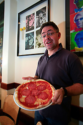 "UNITED KINGDOM WIMBLEDON 26JUN09 - Chef Ghio Berni poses with a pizza named after Boris Becker's son, Noah at his restaurant, the San Lorenzo in Wimbledon, Boris Becker's new home in London. The newlyweds Boris Becker & Sharlely ""Lilly"" Kerssenberg have recently moved into a 6-million pound property in Burghley Road, Wimbledon, London...jre/Photo by Jiri Rezac..© Jiri Rezac 2009"