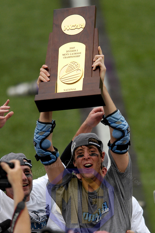 28 May 2007:   Johns Hopkins midfielder Drew Dabrowski holds the championship trophy aloft after Johns Hopkins defeated the Duke University Blue Devils 12-11 to win the NCAA Division I Lacrosse championship at M&T Bank Stadium in Baltimore, Md. .