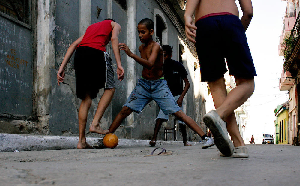 Young boys play soccer on the streets of Old Havana, Cuba.<br />