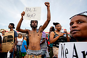 Protesters and demonstrators in the streets of Ferguson, reacting to the death of Michael Brown (18). Michael Brown was fatally shot by police officer Darren Wilson.