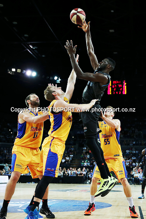 Ekene Ibekwe of the Breakers shoots over Brendan Teys of the 36ers. 2014/15 ANBL, SkyCity Breakers vs Adelaide 36ers, Vector Arena, Auckland, New Zealand. Thursday 12 February 2015. Photo: Anthony Au-Yeung / www.photosport.co.nz