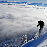 A skier rides above the clouds after taking off from the Ridge at Bridger Bowl Ski Area.  Local ski areas reported receiving more than a foot of snow from this weeks storm.