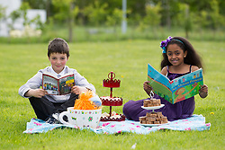 Repro Free: 23/05/2013 Time to Read @ ITB .David Hepes and Nourah Taalib pupils of Castaheany Educate Together NS are pictured celebrating with a Tea Party from the new Butler's Pantry in Castleknock, the completion of ITB's (Institute of Technology Blanchardstown) first 'Time to Read' Project. The 24 week programme with volunteer readers from ITB, helped the children develop a love of reading whilst encrouaging them to become independent readers. Pic Andres Poveda..www.itb.ie .For further information please contact Ann-Marie Sheehan, Aspire PR T : 0872985569 E : annmarie@aspire-pr.com.