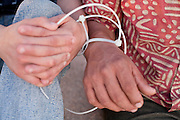 17 MAY 2006 - GILA BEND, AZ: Undocumented Immigrants handcuffed together on the side of a road. Deputies from the Maricopa County Sheriff's Department run an anti-smuggling operation along I-8 near Gila Bend, AZ. Deputies arrested 12 illegal immigrants from Mexico during the operation. PHOTO BY JACK KURTZ