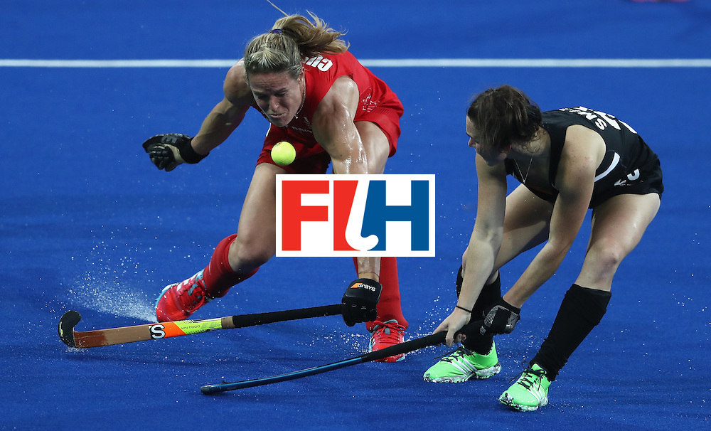 RIO DE JANEIRO, BRAZIL - AUGUST 17:  Crista Cullen (L) of Great Britain is struck in the face by the ball after Kelsey Smith challenges during the Women's hockey semi final match betwen New Zealand and Great Britain on Day12 of the Rio 2016 Olympic Games at the Olympic Hockey Centre on August 17, 2016 in Rio de Janeiro, Brazil.  (Photo by David Rogers/Getty Images)