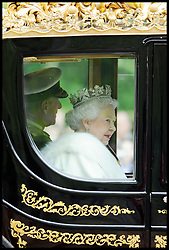 HM The Queen in her carriage as it goes up the Mall towards Parliament for the State Opening of Parliament. Wednesday May 9, 2012.Photo by Andrew Parsons /i-Images