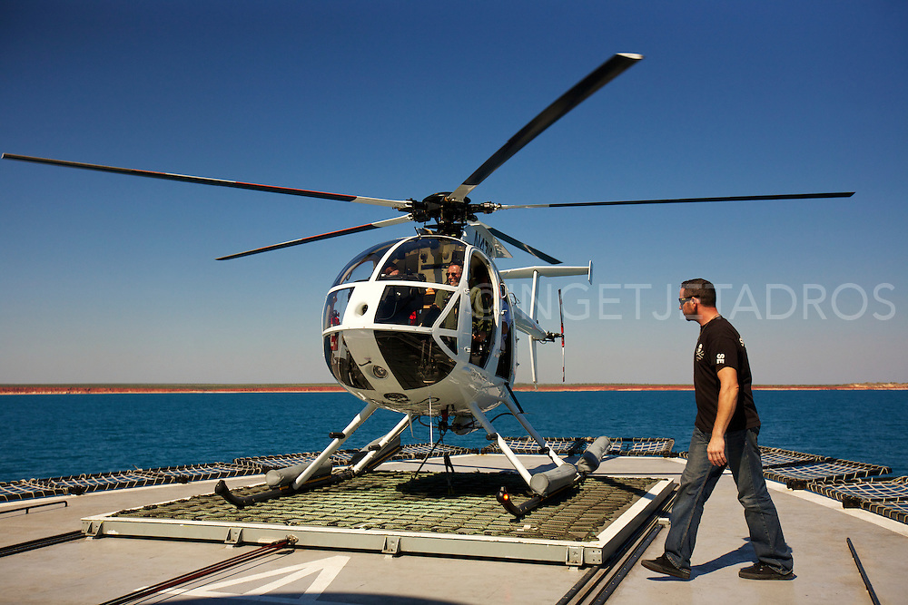 Tim Pierce, checking the helicopter 'Nancy Burnett', on the helicopter platform which is a restricted area on the 'Steve Irwin'. Tim is Seashepherd's Aviation Director, he's a helicopter technician from the USA.