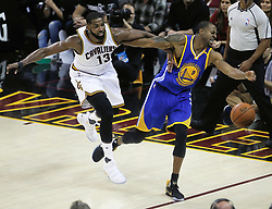 The Cleveland Cavaliers' Tristan Thompson, left, and the Golden State Warriors' Andre Iguodala chase the ball out of bounds in the first quarter during Game 4 of the NBA Finals at Quicken Loans Arena in Cleveland on Friday, June 9, 2017. (Photo by Leah Klafczynski/Akron Beacon Journal/TNS) *** Please Use Credit from Credit Field ***