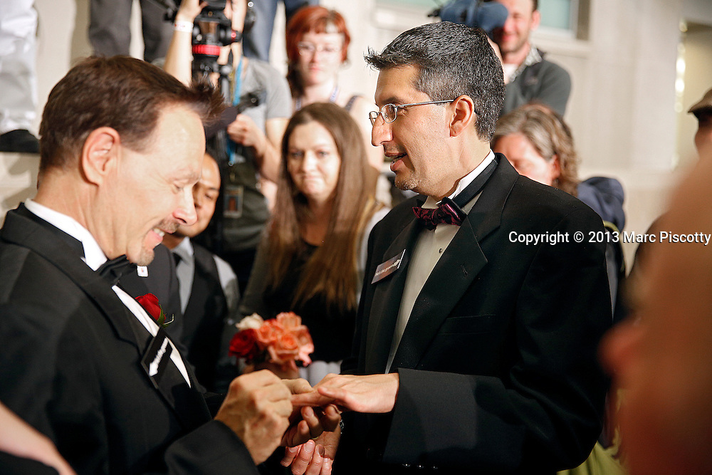 DENVER, CO - MAY 1: David Westman, left, slips a ring on to the finger of Anthony Aragon, both of Denver, Colorado, during a Civil Union ceremony just after midnight in the Denver Office of the Clerk and Recorder at the Wellington E. Webb Municipal Office Building on May 1, 2013 in Denver, Co. State lawmakers passed the Civil Unions bill granting unmarried couples, both gay and heterosexual, rights similar to marriage and Colorado becomes the sixth state to allow civil unions. (Photo by Marc Piscotty / ©2013)