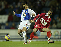 Photo: Aidan Ellis.<br /> Blackburn Rovers v AS Nancy. UEFA Cup. 13/12/2006.<br /> Rovers Sergio Peter (L) loses out to Nancy's Michael Chretien