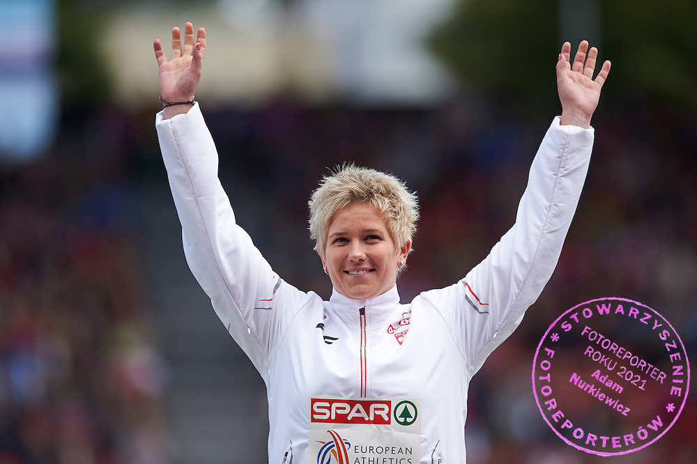 Anita Wlodarczyk from Poland celebrates her gold medal in women's hammer throw while medal ceremony during the Fifth Day of the European Athletics Championships Zurich 2014 at Letzigrund Stadium in Zurich, Switzerland.<br /> <br /> Switzerland, Zurich, August 16, 2014<br /> <br /> Picture also available in RAW (NEF) or TIFF format on special request.<br /> <br /> For editorial use only. Any commercial or promotional use requires permission.<br /> <br /> Photo by &copy; Adam Nurkiewicz / Mediasport