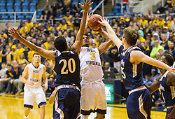 Nov 11, 2016; Morgantown, WV, USA; West Virginia Mountaineers guard James Bolden (3) shoots over Mount St. Mary's Mountaineers guard Sean Gurdon (20) during the second half at WVU Coliseum. Mandatory Credit: Ben Queen-USA TODAY Sports