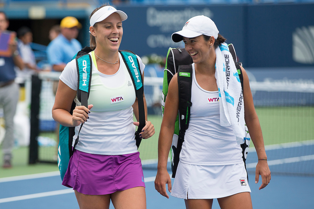 August 22, 2014, New Haven, CT:<br /> Andreja Klepac and Silvia Soler-Espinosa smile as they walk off court after defeating Megan Moulton-Levy and Darija Jurak in the doubles semi-finals on day eight of the 2014 Connecticut Open at the Yale University Tennis Center in New Haven, Connecticut Friday, August 22, 2014.<br /> (Photo by Billie Weiss/Connecticut Open)