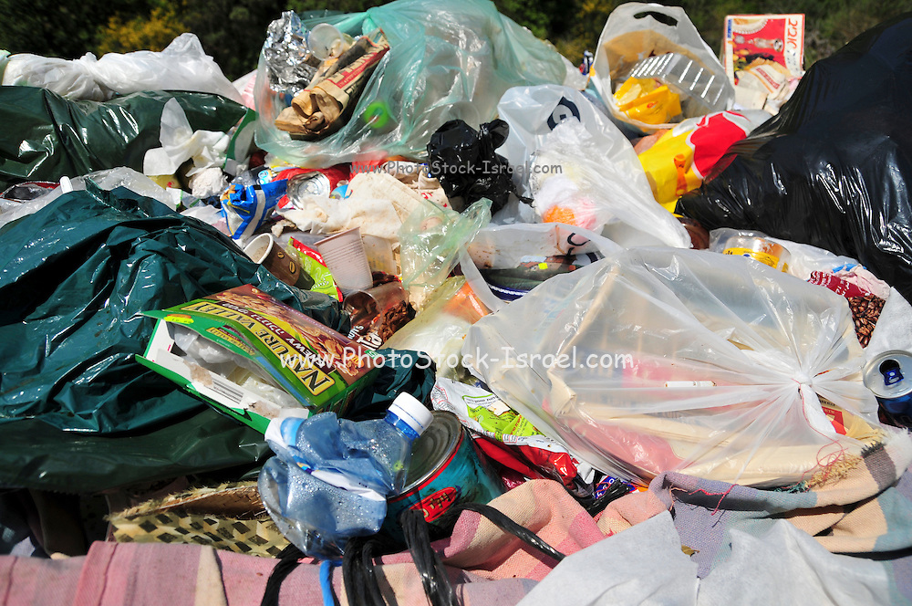 a pile of Plastic bags, Trash and garbage left by travellers and holidaymakers