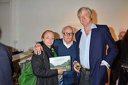 Left to right, CAMILLA LOWTHER, GERRY FARRELL and the MARQUESS OF WORCESTER at a private view of photographs by Jolyon Fenwick 'The Zero Hours Panoramas' 100 Years On: Views From The Parapet of The Somme held at Sladmore Contemporary, 32 Bruton Place, London on 30th June 2016.