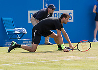 Tennis - 2017 Aegon Championships [Queen's Club Championship] - Day Three, Wednesday<br /> <br /> Men's Singles, Round of 16 - Grigor Dimitrov (BUL) vs Julien Benneteau (FRA)<br /> <br /> Grigor Dimitrov (BUL) slips at Queens Club<br /> <br /> COLORSPORT/DANIEL BEARHAM