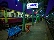 31 MAY 2017 - CHACHOENGSAO, THAILAND:  The first train of the day waits for passengers to board at the train station in Chachoengsao, a provincial town about 50 miles and about an hour by train from Bangkok. The train from Chachoengsao to Bangkok takes a little over an hour but traffic on the roads is so bad that the same drive can take two to three hours. Thousands of Thais live outside of Bangkok and commute into the city for work on trains, busses and boats.      PHOTO BY JACK KURTZ