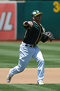 May 29, 2014; Oakland, CA, USA; Oakland Athletics third baseman Josh Donaldson (20) throws the baseball to first base during the third inning against the Detroit Tigers at O.co Coliseum. The Tigers defeated the Athletics 5-4.