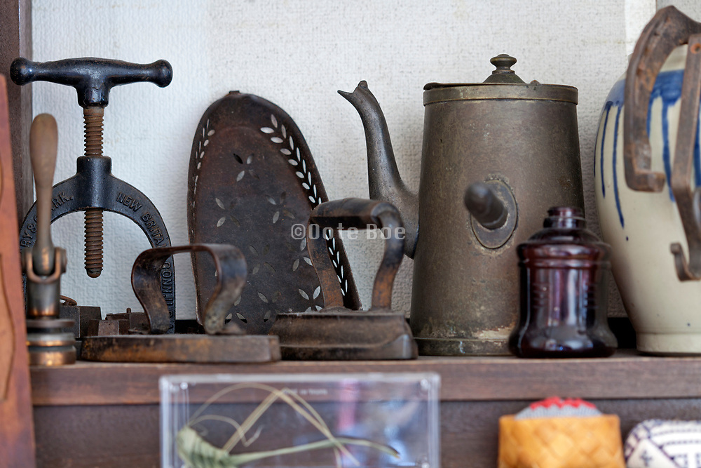 various vintage objects displayed on a shelf