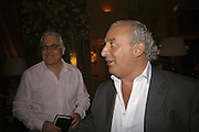 Bill Kenwright and Philip Green. launch of The Bar at the Dorchester. Park Lane. London. 27 June 2006. ONE TIME USE ONLY - DO NOT ARCHIVE  © Copyright Photograph by Dafydd Jones 66 Stockwell Park Rd. London SW9 0DA Tel 020 7733 0108 www.dafjones.com