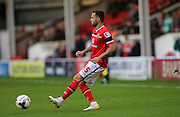 Walsall striker, Milan Lalkovic plays a short pass during the Capital One Cup match between Walsall and Brighton and Hove Albion at the Banks's Stadium, Walsall, England on 25 August 2015.