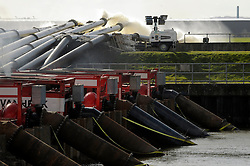 © Licensed to London News Pictures. 22/02/2014; Dunball, Somerset. Giant flood pumps from the Netherlands at Dunball Wharf near Bridgwater are pumping millions of gallons of flood water off the Somerset levels via King Sedgemoor Drain and the River Parrett.<br /> Photo credit: Simon Chapman/LNP