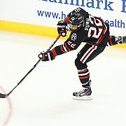 Tanner Pond #22 of the Northeastern Huskies shoots the puck during The Beanpot Championship Game at TD Garden on February 10, 2014 in Boston, Massachusetts. (Photo by Elan Kawesch)