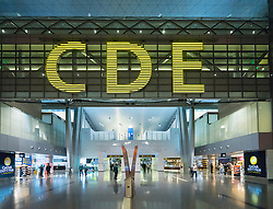 Interior of modern passenger terminal building at new Hamad International Airport in Doha Qatar