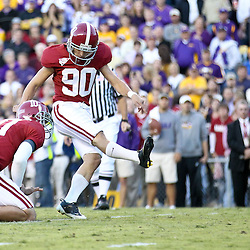 November 6, 2010; Baton Rouge, LA, USA; Alabama Crimson Tide kicker Jeremy Shelley (90) kicks during the second half against the LSU Tigers at Tiger Stadium. LSU defeated Alabama 24-21.  Mandatory Credit: Derick E. Hingle