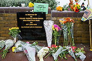 A commemoration plaque to remember 58 Chinese refugees that died in a vehicle as it arrived at Dover is surrounded by flowers placed by locals from Dover, Folkestone and Thanet demonstrating to welcome refugees into the UK via Dover. Organised by Kent anti racism network. Dover, Kent.