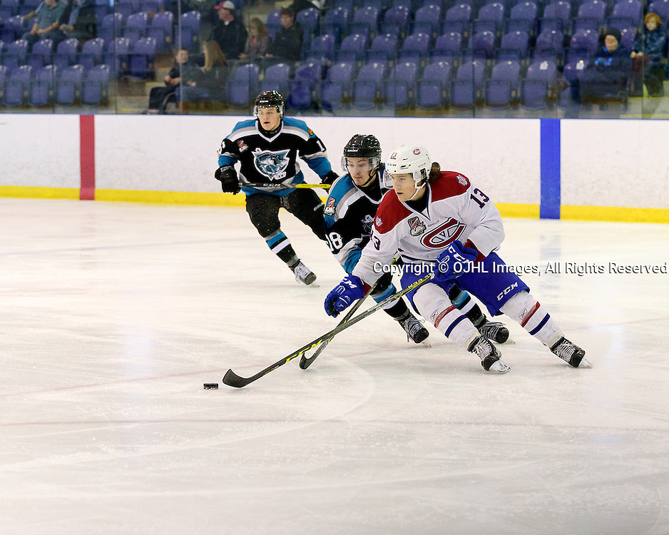 KINGSTON, ON - FEB 19,  2017: Ontario Junior Hockey League game between   Lindsay Muskies and Kingston Voyageurs, Kyle Hallbauer #13 of the Kingston Voyageurs skates with the puck while being pursued by Ethan Ramsden #18 of the Lindsay Muskies during the 2nd period.<br /> (Photo by Ian Dixon/ OJHL Images)
