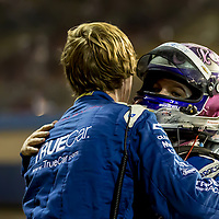 Katherine Legge gives one of her crew a hug after the 2012 Indycar race the Fontana 500