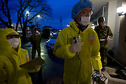 Staff and members of Japan's Self Defense Forces administer radiation checks at  a health center in Minami-Soma, Fukushima Prefecture, Japan on 30 March, 2011.  Photographer: Robert Gilhooly