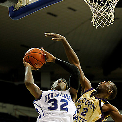 November 27, 2011; New Orleans, LA; New Orleans Privateers forward Lovell Cook (32) shoots as Alcorn State Braves forward Chris Brand (22) defends during the first half of a game at the Lakefront Arena.  Mandatory Credit: Derick E. Hingle-US PRESSWIRE