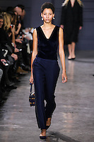 Lineisy Montero walks the runway wearing Jason Wu Fall 2016, Hair by Paul Hanlon for Morocconoil, Makeup by Yadim for Maybelline, shot by Thomas Concordia during New York Fashion Week on February 12, 2016
