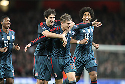 19.02.2014, Emirates Stadion, London, ENG, UEFA CL, FC Arsenal vs FC Bayern Muenchen, Achtelfinale, im Bild l-r: Torjubel von Javi MARTINEZ #8 (FC Bayern Muenchen), Toni KROOS #39 (FC Bayern Muenchen), DANTE #4 (FC Bayern Muenchen) // during the UEFA Champions League Round of 16 match between FC Arsenal and FC Bayern Munich at the Emirates Stadion in London, Great Britain on 2014/02/19. EXPA Pictures © 2014, PhotoCredit: EXPA/ Eibner-Pressefoto/ Kolbert<br /> <br /> *****ATTENTION - OUT of GER*****