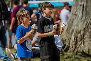 Children enjoy ice cream as the sun beats down on the festival - The 2016 Latitude Festival, Henham Park, Suffolk.