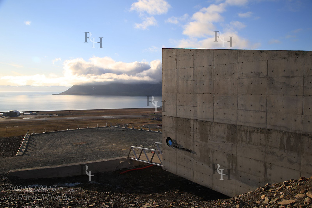 Global Seed Vault overlooks Adventfjorden and Isfjorden from rocky hillside in mid summer in Longyearbyen on Spitsbergen island, Svalbard, Norway.