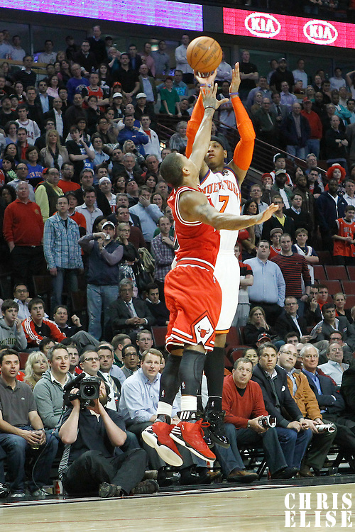 12 March 2012: New York Knicks small forward Carmelo Anthony (7) takes a jumpshot over Chicago Bulls point guard Derrick Rose (1) during the Chicago Bulls 104-99 victory over the New York Knicks at the United Center, Chicago, Illinois, USA.