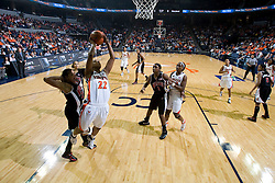 Virginia guard Monica Wright (22) shoots over Maryland guard/forward Marissa Coleman (25).  The Virginia Cavaliers women's basketball team fell to the #4 ranked Maryland Terrapins 74-62 at the John Paul Jones Arena in Charlottesville, VA on January 18, 2008.