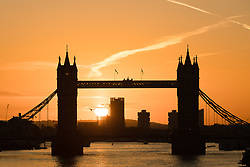© Licensed to London News Pictures. 30/10/2017. LONDON, UK.  Sunrise behind Tower Bridge on the River Thames.  London has woken to cold and clear weather this morning. Photo credit: Vickie Flores/LNP
