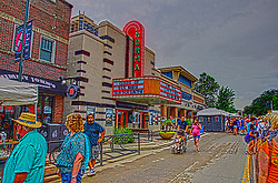 11 July 2015:  The crowds swell the streets as the parking lots become full for the 2015 Sugar Creek Arts Festival in Uptown Normal Illinois.<br /> <br /> This images is a High Dynamic Range (HDR) composite image that has been manipulated using computer software.