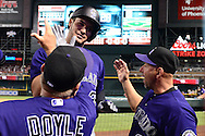 Apr 29, 2016; Phoenix, AZ, USA; Colorado Rockies third baseman Nolan Arenado (28) is congratulated by hitting coach Blake Doyle (25) and manager Walt Weiss (22) after hitting a solo home run against the Arizona Diamondbacks in the fifth inning at Chase Field. Mandatory Credit: Jennifer Stewart-USA TODAY Sports